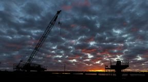 Dawn Bridge Building. New bridge getting built with a use of a crain royalty free stock image