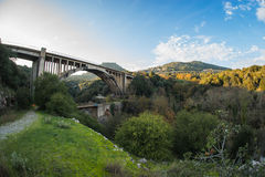New bridge and old bridge with a small chapel at Karytaina, Pelo. Image of New bridge and old bridge with a small chapel at Karytaina, Peloponnese, Greece Royalty Free Stock Photos