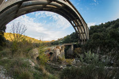 New bridge and old bridge with a small chapel at Karytaina, Pelo. Image of New bridge and old bridge with a small chapel at Karytaina, Peloponnese, Greece Royalty Free Stock Images