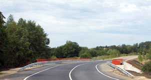 New bridge on suburban road with orange fence Stock Photography