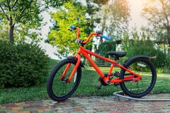 Free New Bright Red Color Teen Bike Stand In Garden At Home Backyard. Child Birthday Gift Present. Kid Sport Outdoor Activity Royalty Free Stock Photo - 194145915