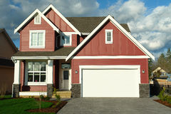 New Red House Home With White Trim stock photo