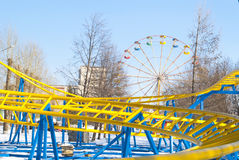 New bright roller coaster in winter park Stock Images