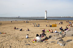 NEW BRIGHTON, UK - 8 AUGUST 2015. Busy beach on a hot day in summer Royalty Free Stock Images