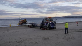 New British lifeboat landing on Exmouth beach in Devon UK after sea trials. This boat is the latest most agile in the RNLI`s fleet Royalty Free Stock Photography