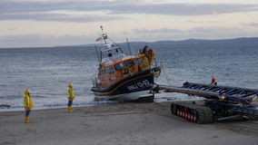 New British lifeboat landing on Exmouth beach in Devon UK after sea trials. This boat is the latest most agile in the RNLI`s fleet Stock Photos