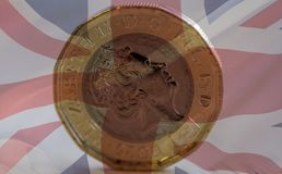 New British One Pound Coin Blended With Union Jack A. Shallow Depth of Field Royalty Free Stock Images