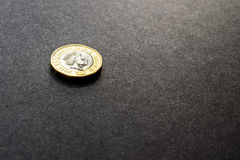 New british one sterling pound coin on dark background.  Stock Photography