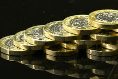 New British pound coins. On a black background Royalty Free Stock Photo