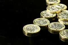 New British pound coins. On a black background Royalty Free Stock Images