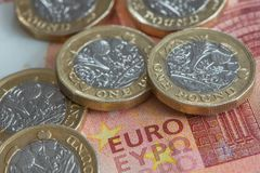New British pound coins on Euro banknote. A close up view of new British Pound coins set on a Euro note Stock Images