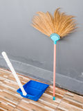 New broom and the plastic dustpan. Royalty Free Stock Photo