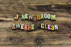 New broom sweeps clean improvement honesty efficiency leadership. New day broom sweeps clean improvement truth honesty efficiency leadership typography word time royalty free stock photo