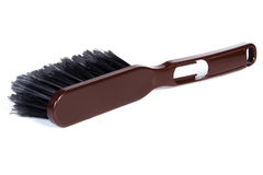 New brown broom for cleaning on white background Royalty Free Stock Photos