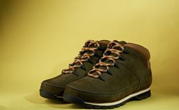 New brown hike shoes. On yellow background. Hike boots pair Royalty Free Stock Image