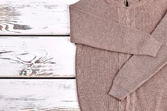 New brown knitted pullover close up. High quality brown cardigan for kids casual wear. Autumn warm knit outfit Stock Photo