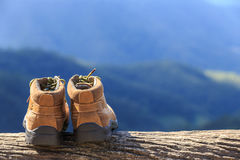 New brown leather shoe on mountain view point. Adventure concept. Close up new brown leather shoe on mountain view point. Adventure concept stock images