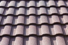 New brown roof tile close up. background texture. hight contrast stock photos