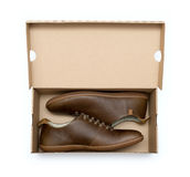 New brown shoe in box Stock Photos
