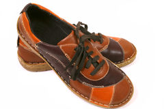New brown shoes. New woman brown low shoes made of patchwork leather. Original fashion Royalty Free Stock Images