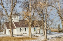 New Brown Steel Roof. White, country church with a new brown steel roof on a winter day Stock Photography