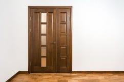 New brown wooden door in house interior stock images