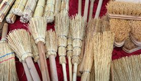 New brushes and brooms in sorghum for sale at market. New brushes and small brooms in sorghum at market stock photo