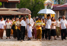 New Buddhist Monk Ceremony in Koh Samui. A ceremony taking place in Thailand for a new Buddhist Monk. The monk in white is walking around the temple with family royalty free stock photos