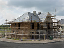The new build. New build huome surrounded by fencing and scaffolding Royalty Free Stock Photography
