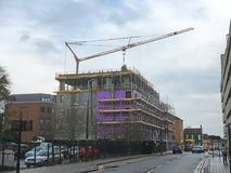 New build with crane and scaffolding. Town center. Royalty Free Stock Photo