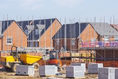 New build houses building construction site, Cheshire, England,. New build houses in scaffolding on construction site in Cheshire England United Kingdom stock photo