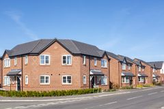 New build houses in Cheshire England UK. New housing estate, build on formely ERF truckmakers site in Sandbach, Cheshire, England, United Kingdom royalty free stock photography