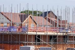Houses under construction in Cheshire UK. New build houses in scaffolding in Cheshire England United Kingdom royalty free stock photography