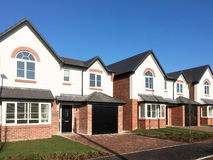 New build houses UK. New build houses with garage UK royalty free stock images