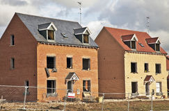 New build housing. New build homes forming part of a new estate for private and social housing.Both of these houses are still under construction Royalty Free Stock Images