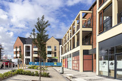 New Build. Image of a new community in the building stage, with new apartment blocks and local stores Stock Photos