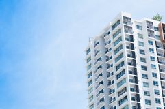 New building architecture on blue sky background stock images