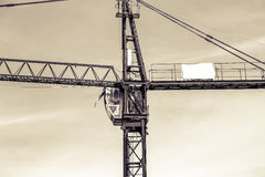 A New building is being constructed with use of tower crane Stock Photos
