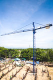 A New building is being constructed with use of tower crane Stock Photo