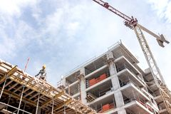 Construction Site Wiew. A new building is being constructed with use of tower crane Royalty Free Stock Photos