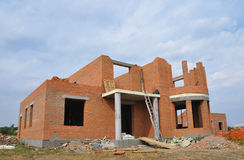 New  Building  Brick House Construction with Doorway Columns. And Windows frame Exterior. Building Site Outside Royalty Free Stock Photography