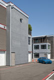 New building with car. A new office building warehouse with a car in front Stock Images