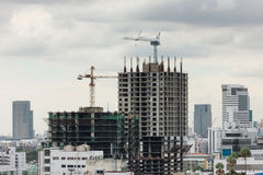New building construction in a heavily congested urban area Stock Image