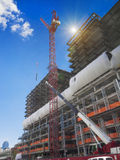 New building construction site. With crane depositing steel beams Stock Photo