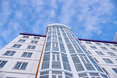 New building. With a facade PVC windows and blue sky with clouds Royalty Free Stock Image