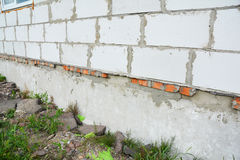 New building house construction foundation wall waterproofing. Close up on new building house construction foundation wall waterproofing. Properly insulated Stock Image
