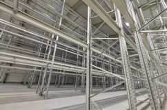 New building lot of high bay stock. With steel shelves royalty free stock photo