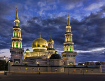 The new building of a mosque in Moscow. Is beautifully lit in the evening Stock Image