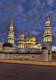 The new building of a mosque in Moscow. Is beautifully lit in the evening Stock Photos