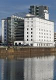 New building at an old habour. A new building at an old habour Royalty Free Stock Image